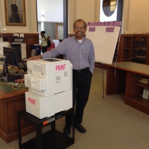 LTS Chief Information Officer Ravi Ravishanker poses near a new printer.