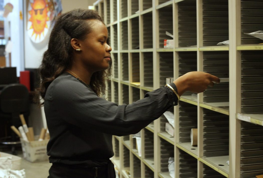 Tashay Campbell '18 working at mail services. | Photo by Audrey Stevens '17