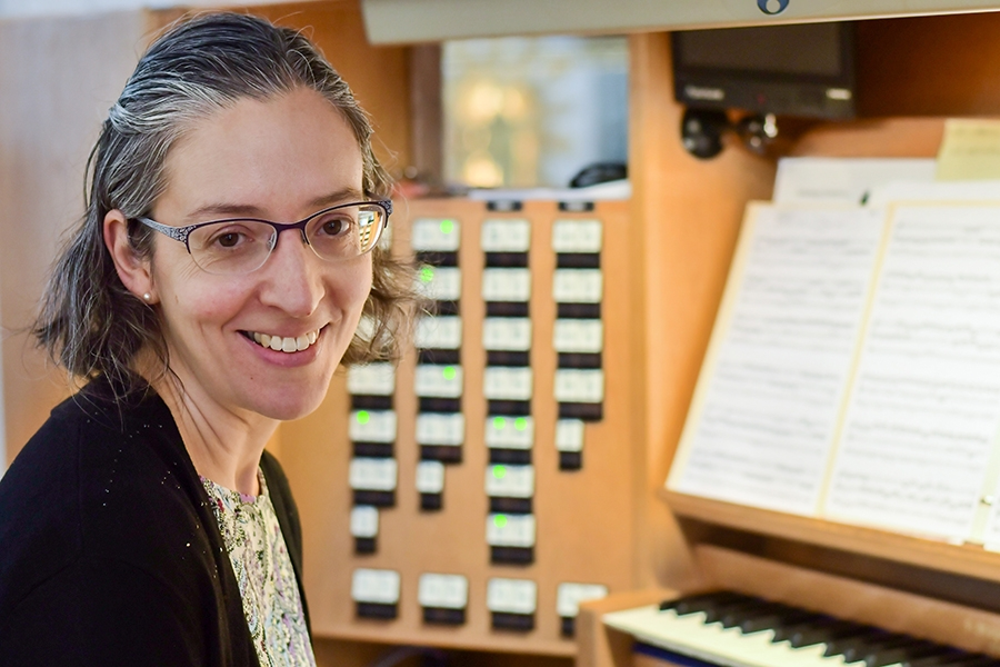 Erica next to an organ
