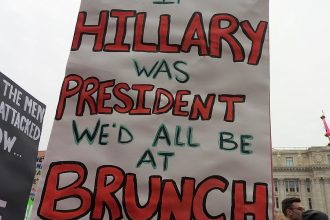 """Sign at a protest that states, """"If Hillary was president we'd all be at brunch"""""""
