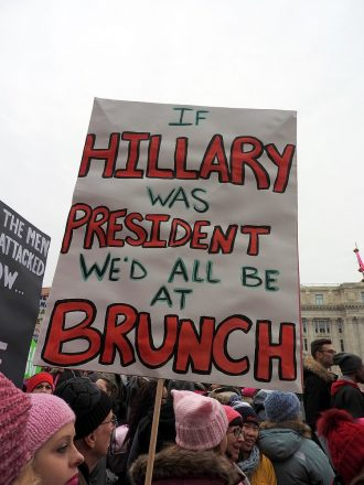 "Sign at a protest that states, ""If Hillary was president we'd all be at brunch"""