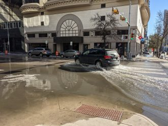 A flooded street in Austin during the thaw following 2021 snowstorm