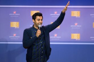 Picture of comedian Hasan Minhaj performing a comedy show
